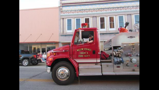 The Willow Springs Fire Department lit up the parade with lights and sirens. Fire Chief Donald Worley waives to the crowd. (photo credit: Amanda Mendez)