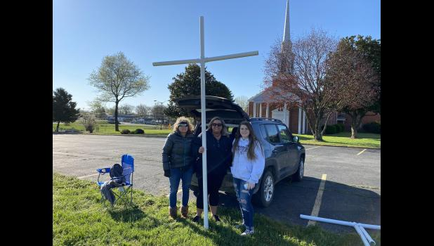 Lisa Johnson and Braden and Jill Harring carrying their cross in front of the First Baptist Church in Mountain View. (photo credit: Braden Marriott)