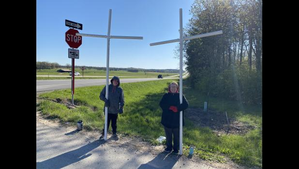 Gail Marriott and Zach Long holding the first set of crosses coming into Mountain View by Gentleman Jim's Repair. (photo credit: Braden Marriott)