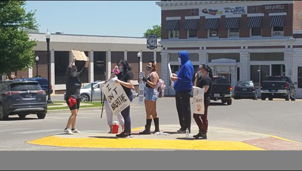 A gathering of protesters on the Square in West Plains holding signs and wearing masks on June 2. (photo credit: Jeremiah Johnson)
