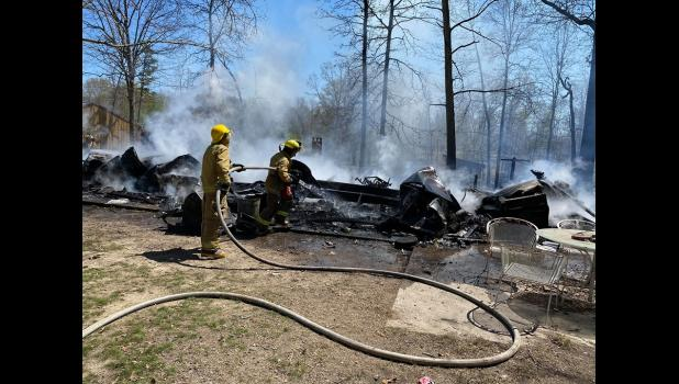 Firefighters attempt to quench the fire that consumed this trailer house in Peace Valley (photo credit: Braden Marriott)